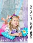lovely girl with a unicorn hoop ... | Shutterstock . vector #636761551