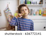 cute little boy in pajama... | Shutterstock . vector #636772141
