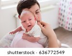 young father burping his... | Shutterstock . vector #636772549