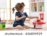 little cute girl playing with... | Shutterstock . vector #636854929