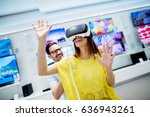 happy couple trying on 3d... | Shutterstock . vector #636943261