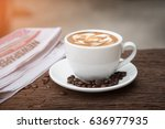 coffee mug with newspaper on... | Shutterstock . vector #636977935