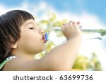 child drinking pure water in... | Shutterstock . vector #63699736