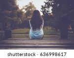 lonely woman in white casual... | Shutterstock . vector #636998617