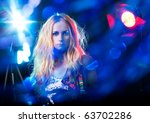 beautiful young woman under the ... | Shutterstock . vector #63702286