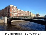 Small photo of View of the Krasnoflotsky Bridge and the Central Naval Museum. River Moyka, St. Petersburg