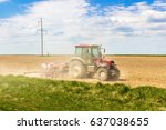 tractor in the field | Shutterstock . vector #637038655