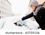 Woman Removing Snow From Car...