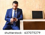 young man with mobile phone and ... | Shutterstock . vector #637075279