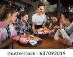 young waitress serving burgers... | Shutterstock . vector #637092019