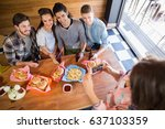 high angle view of woman... | Shutterstock . vector #637103359