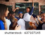friends watching game in sports ... | Shutterstock . vector #637107145