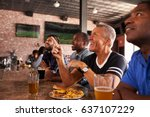 male friends at counter in... | Shutterstock . vector #637107229