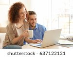 happy young couple with laptop...   Shutterstock . vector #637122121
