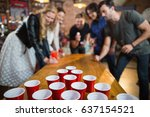 Friends Enjoying Beer Pong Gam...