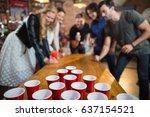 friends enjoying beer pong game ... | Shutterstock . vector #637154521
