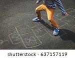 little boy playing hopscotch on ... | Shutterstock . vector #637157119