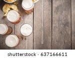 glass beer on wood background | Shutterstock . vector #637166611