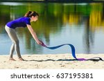 young brunette in blue sports t ... | Shutterstock . vector #637195381