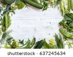 fresh green vegetables on a... | Shutterstock . vector #637245634