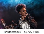 female singer with microphone... | Shutterstock . vector #637277401