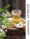Small photo of Acacia honey in glass jar and flowering acacia