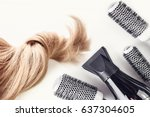 hairdresser tools and blond... | Shutterstock . vector #637304605