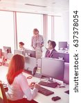business people working in an... | Shutterstock . vector #637378054