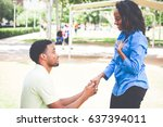 Small photo of Portrait of young man dropping on knees to propose and lady answering i do, isolated outdoors outside background
