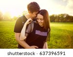 couple hugging in the park in... | Shutterstock . vector #637396591