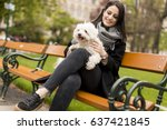 young woman sitting in the park ... | Shutterstock . vector #637421845