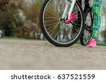 a girl rides a bicycle. close... | Shutterstock . vector #637521559