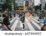 portrait girl crossing busy... | Shutterstock . vector #637594957