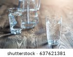 glass of water on a wooden... | Shutterstock . vector #637621381