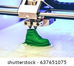 Small photo of 3D printer prints the form of molten plastic green close-up. Automatic three dimensional 3d printer performs plastic modeling in laboratory. Progressive modern additive technology