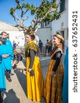Small photo of Saint-Marie-de-la-Mer, Provence, France - May 25, 2015. World Festival of Gypsies. Participants of a carnival in medieval suits and city visitors. Square in front of the cathedral