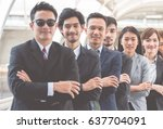 Small photo of Boss and his henchman standing in row show team work