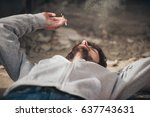 closeup of young man lying on... | Shutterstock . vector #637743631