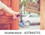 women hand close door knob or...   Shutterstock . vector #637866751