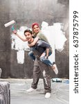 young happy couple with paint... | Shutterstock . vector #637875799