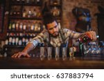 waiter pouring tequila into... | Shutterstock . vector #637883794