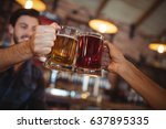 two young men toasting their... | Shutterstock . vector #637895335
