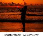 asian women on the beach at...   Shutterstock . vector #637898899
