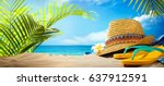 straw hat and flip flops on... | Shutterstock . vector #637912591