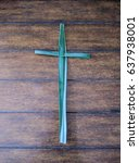 cross made up of palm leaves on ... | Shutterstock . vector #637938001