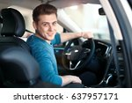 happy young male driver behind... | Shutterstock . vector #637957171