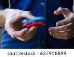 male hand holding popular... | Shutterstock . vector #637958899
