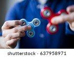 male hand holding popular... | Shutterstock . vector #637958971