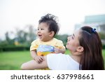 cheerful mother holding her son ... | Shutterstock . vector #637998661