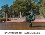 Small photo of STOCKHOLM, SWEDEN 2016 August27: Sculptures Sun Glitter or Naiad on dolphin (1918) and Angel Musicians (1949) in Millesgarden. Statues created by Swedish sculptor Carl Milles. Staircase, trees on back